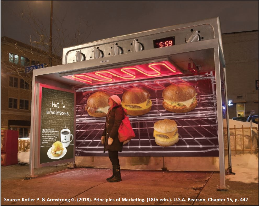 The oven-looking bus shelter that contains an advertisement for Caribou Coffee shows a creative mood or image advertising style.